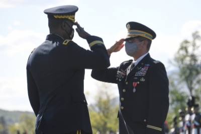 Col. Bill Wanovich '87 Salutes MG Wins '85 at parade for retirement